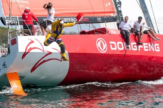 NEWPORT, RI - MAY 17: In this handout image provided by the Volvo Ocean Race, an on-board reporter jumps off the Dongfeng boat during the start of Leg 7 from Newport to Lisbon on May 17, 2015 in Newport, Rhode Island. The Volvo Ocean Race 2014-15 is the 12th running of this ocean marathon. Starting from Alicante in Spain on October 11, 2014, the route, spanning some 39,379 nautical miles, visits 11 ports in eleven countries (Spain, South Africa, United Arab Emirates, China, New Zealand, Brazil, United States, Portugal, France, The Netherlands and Sweden) over nine months. The Volvo Ocean Race is the world's premier ocean yacht race for professional racing crews. (Photo by Billie Weiss / Volvo Ocean Race via Getty Images)