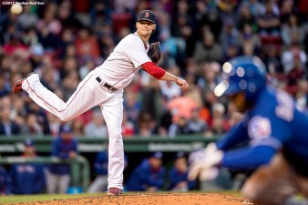 """Boston Red Sox pitcher Clay Buchholz attempts a pick-off during the third inning of a game against the Texas Rangers at Fenway Park in Boston, Massachusetts Thursday, May 21, 2015."""