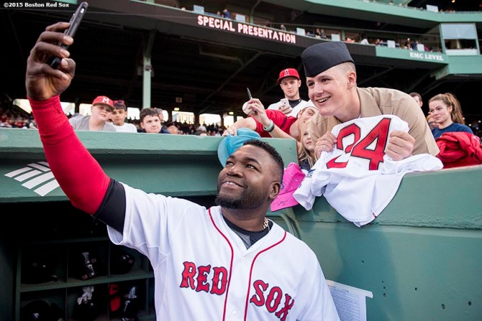 """Boston Red Sox designated hitter David Ortizl poses for a selfie photograph with a member of the military before a game between the Boston Red Sox and the Texas Rangers at Fenway Park in Boston, Massachusetts Saturday, May 23, 2015."""