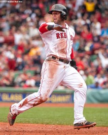"""Boston Red Sox second baseman Dustin Pedroia rounds third base during the third inning of a game against the Minnesota Twins at Fenway Park in Boston, Massachusetts Wednesday, June 3, 2015."""