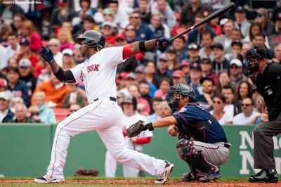 """Boston Red Sox left fielder Hanley Ramirez hits an RBI single during the fourth inning of a game against the Minnesota Twins at Fenway Park in Boston, Massachusetts Wednesday, June 3, 2015."""