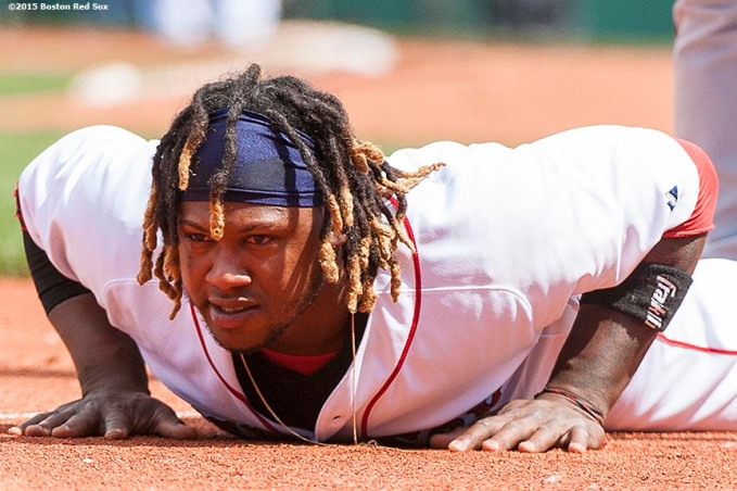 """Boston Red Sox left fielder Hanley Ramirez reacts after sliding into third base during the fifth inning of a game against the Minnesota Twins at Fenway Park in Boston, Massachusetts Wednesday, June 3, 2015."""
