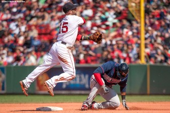 """Boston Red Sox second baseman Dustin Pedroia turns a double play during the eighth inning of a game against the Minnesota Twins at Fenway Park in Boston, Massachusetts Wednesday, June 3, 2015."""