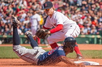 """Boston Red Sox third baseman Brock Holt applies a tag during the eighth inning of a game against the Minnesota Twins at Fenway Park in Boston, Massachusetts Wednesday, June 3, 2015."""
