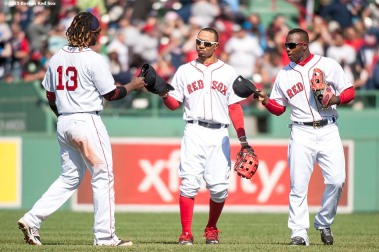 """Boston Red Sox left fielder Hanley Ramirez, center fielder Mookie Betts and right fielder Rusney Castillo tip their caps together after defeating the Minnesota Twins at Fenway Park in Boston, Massachusetts Wednesday, June 3, 2015."""