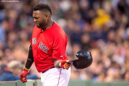 """Boston Red Sox designated hitter David Ortiz throws his helmet during the fourth inning of the second game of a day-night double header against the Minnesota Twins at Fenway Park in Boston, Massachusetts Wednesday, June 3, 2015."""