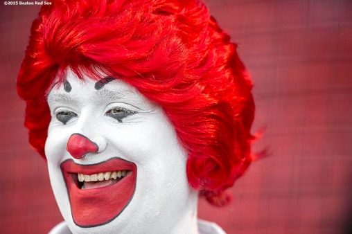 """Ronald McDonald smiles before a game between the Boston Red Sox and the Minnesota Twins at Fenway Park in Boston, Massachusetts Wednesday, June 3, 2015."""