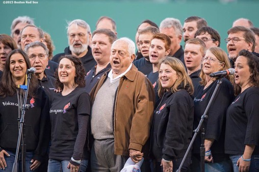 """Tommy Lasorda sings the National Anthem with members of the Voices of Hope Choir before a game between the Boston Red Sox and the Minnesota Twins at Fenway Park in Boston, Massachusetts Wednesday, June 3, 2015."""