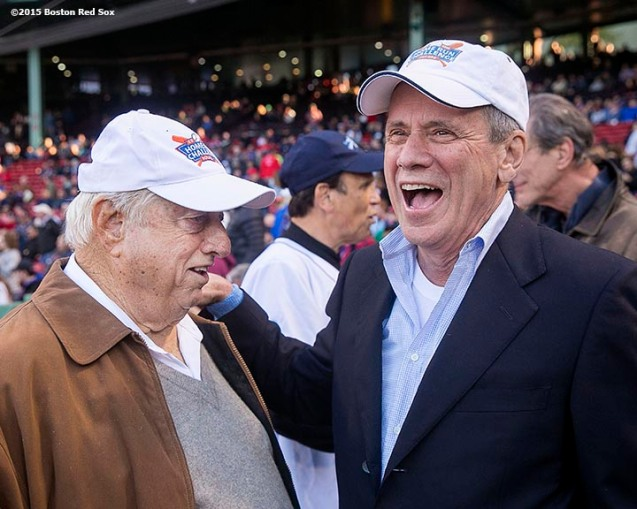 """Boston Red Sox President & CEO Larry Lucchino talks with Tommy Lasorda before a game between the Boston Red Sox and the Minnesota Twins at Fenway Park in Boston, Massachusetts Wednesday, June 3, 2015."""