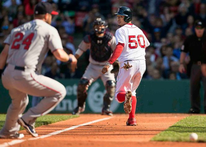 """Boston Red Sox center fielder Mookie Betts runs toward home plate during a game against the Minnesota Twins at Fenway Park in Boston, Massachusetts Thursday, June 4, 2015."""