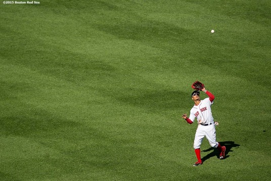 """Boston Red Sox center fielder Mookie Betts catches a fly ball during a game against the Minnesota Twins at Fenway Park in Boston, Massachusetts Thursday, June 4, 2015."""