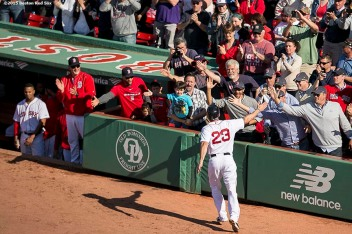 """Boston Red Sox catcher Blake Swihart high fives fans after hitting a solo home run during a game against the Minnesota Twins at Fenway Park in Boston, Massachusetts Thursday, June 4, 2015. It was his first career Major League home run."""