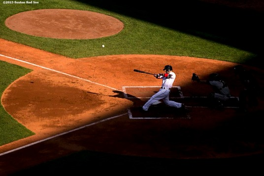 """Boston Red Sox second baseman Dustin Pedroia hits a home run during a game against the Minnesota Twins at Fenway Park in Boston, Massachusetts Thursday, June 4, 2015."""
