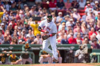 """Boston Red Sox third baseman Pablo Sandoval throws to first base during the third inning of a game against the Oakland Athletics at Fenway Park in Boston, Massachusetts Sunday, June 7, 2015."""