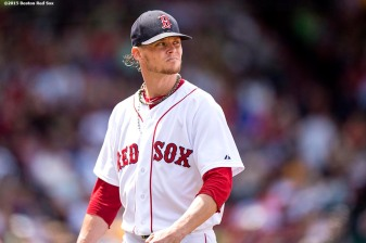 """""""Boston Red Sox pitcher Clay Buchholz reacts during the fourth inning of a game against the Oakland Athletics at Fenway Park in Boston, Massachusetts Sunday, June 7, 2015."""""""