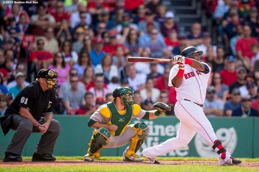 """Boston Red Sox third baseman Pablo Sandoval hits an RBI single during the eighth inning of a game against the Oakland Athletics at Fenway Park in Boston, Massachusetts Sunday, June 7, 2015."""