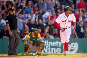 """Boston Red Sox shortstop Xander Bogaerts hits a go-ahead RBI double during the eighth inning of a game against the Oakland Athletics at Fenway Park in Boston, Massachusetts Sunday, June 7, 2015."""
