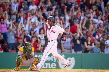 """Boston Red Sox left fielder Hanley Ramirez reacts as he scores the go-ahead run during the eighth inning of a game against the Oakland Athletics at Fenway Park in Boston, Massachusetts Sunday, June 7, 2015."""
