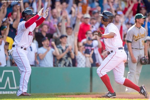 """""""Boston Red Sox shortstop Xander Bogaerts reacts as he scores during the inning of a game against the Oakland Athletics at Fenway Park in Boston, Massachusetts Sunday, June 7, 2015."""""""