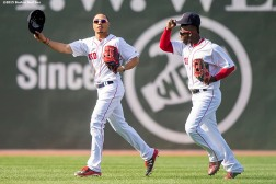 """Boston Red Sox outfielders Mookie Betts and Rusney Castillo react after defeating the Oakland Athletics at Fenway Park in Boston, Massachusetts Sunday, June 7, 2015."""