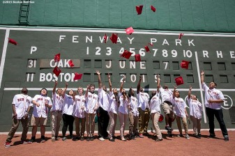 """""""Members of the Red Sox Scholars program pose for a group photograph in front of the Green Monster before a game between the Boston Red Sox and the Oakland Athletics at Fenway Park in Boston, Massachusetts Sunday, June 7, 2015."""""""