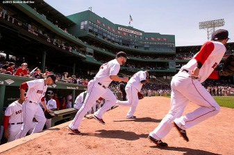 """""""Members of the Boston Red Sox take the field before a game against the Oakland Athletics at Fenway Park in Boston, Massachusetts Sunday, June 7, 2015."""""""