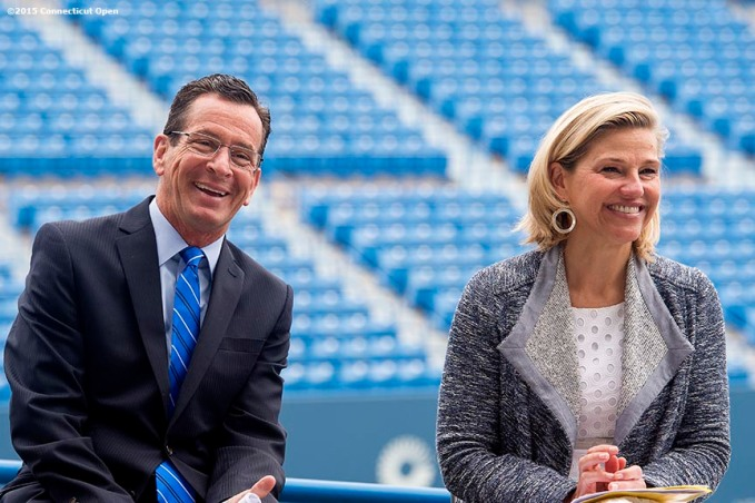 """Connecticut Governor Dannel P. Malloy and Tournament Director Anne Worcester laugh during a press conference at the Connecticut Tennis Center to announce the new Connecticut Open 50/50 Project and the renewal of United Technologies sponsorship of the tournament through the 2017 in New Haven, Connecticut Tuesday, June 9, 2015."""