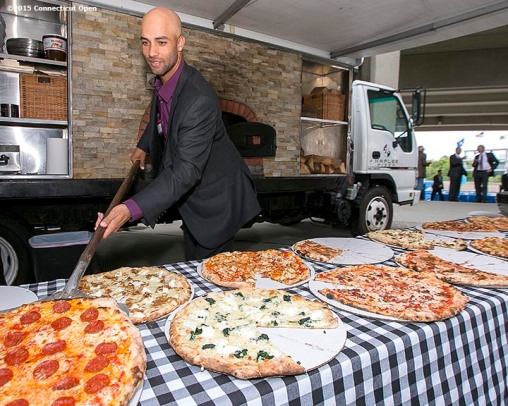 """Former ATP World Tour star and Connecticut Open Legends Event Participant James Blake serves Naples Pizza to guests during a press conference at the Connecticut Tennis Center to announce the new Connecticut Open 50/50 Project and the renewal of United Technologies sponsorship of the tournament through the 2017 in New Haven, Connecticut Tuesday, June 9, 2015."""
