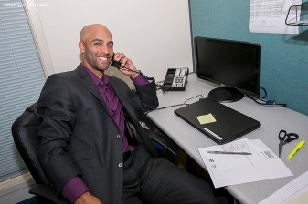 """""""Former ATP World Tour star and Connecticut Open Legends Event Participant James Blake makes calls to ticket holders during a press conference at the Connecticut Tennis Center to announce the new Connecticut Open 50/50 Project and the renewal of United Technologies sponsorship of the tournament through the 2017 in New Haven, Connecticut Tuesday, June 9, 2015."""""""