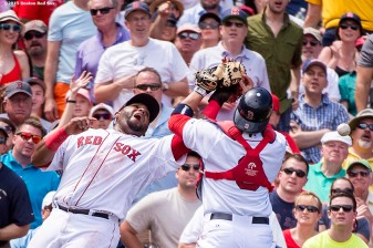 """""""Boston Red Sox catcher Sandy Leon and third baseman Pablo Sandoval collide while attempting to catch a foul ball during the third inning of a game against the Toronto Blue Jays at Fenway Park in Boston, Massachusetts Saturday, June 13, 2015."""""""