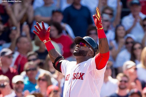 """""""Boston Red Sox designated hitter David Ortiz reacts after hitting a solo home run during the sixth inning of a game against the Toronto Blue Jays at Fenway Park in Boston, Massachusetts Saturday, June 13, 2015."""""""