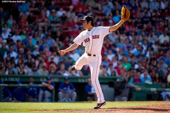 """""""Boston Red Sox pitcher Koji Uehara delivers during the ninth inning of a game against the Toronto Blue Jays at Fenway Park in Boston, Massachusetts Saturday, June 13, 2015."""""""