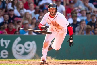 """Boston Red Sox pitcher second baseman Dustin Pedroia bats during the ninth inning of a game against the Toronto Blue Jays at Fenway Park in Boston, Massachusetts Saturday, June 13, 2015."""