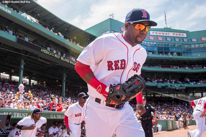 """""""Right fielder Alejandro De Aza runs onto the fieldbefore a game between the Boston Red Sox and the Toronto Blue Jays at Fenway Park in Boston, Massachusetts Saturday, June 13, 2015."""""""