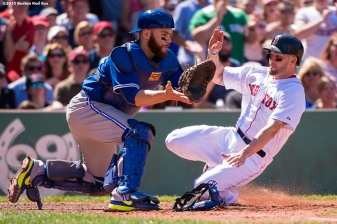 """Boston Red Sox catcher Blake Swihart slides into home as he scores during the fifth inning of a game against the Toronto Blue Jays at Fenway Park in Boston, Massachusetts Sunday, June 14, 2015."""