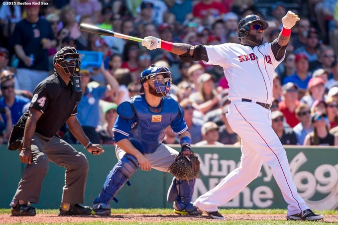 """""""Boston Red Sox designated hitter David Ortiz hits a three run home run during the fifth inning of a game against the Toronto Blue Jays at Fenway Park in Boston, Massachusetts Sunday, June 14, 2015."""""""