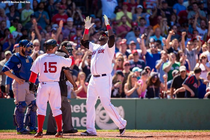 """""""Boston Red Sox designated hitter David Ortiz reacts after hitting a three run home run during the fifth inning of a game against the Toronto Blue Jays at Fenway Park in Boston, Massachusetts Sunday, June 14, 2015."""""""