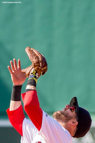 """Boston Red Sox second baseman Dustin Pedroia catches a fly ball during the seventh inning of a game against the Toronto Blue Jays at Fenway Park in Boston, Massachusetts Sunday, June 14, 2015."""
