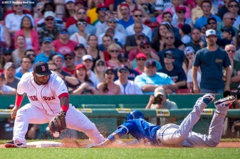 """""""Boston Red Sox third baseman Pablo Sandoval applies a tag during the seventh inning of a game against the Toronto Blue Jays at Fenway Park in Boston, Massachusetts Sunday, June 14, 2015."""""""