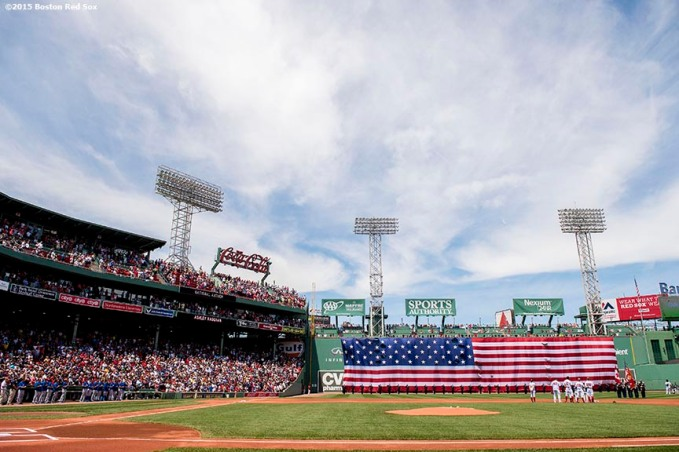 """The American flag is dropped over the Green Monster before a game between the Boston Red Sox and the Toronto Blue Jays at Fenway Park in Boston, Massachusetts Sunday, June 14, 2015."""