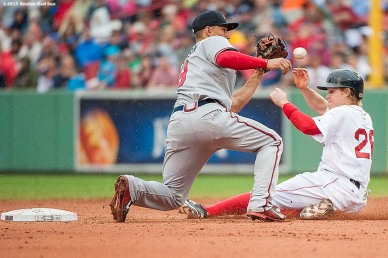 """Boston Red Sox third baseman Brock Holt is tagged out as he attempts to steal during the fifth inning of a game against the Atlanta Braves at Fenway Park in Boston, Massachusetts Tuesday, June 16, 2015."""