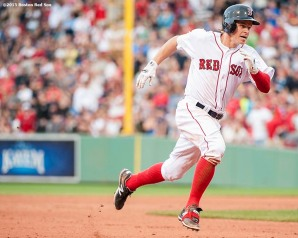 """""""Boston Red Sox second baseman Brock Holt legs out a triple as he hits for the cycle during the eighth inning of a game against the Atlanta Braves at Fenway Park in Boston, Massachusetts Tuesday, June 16, 2015."""""""