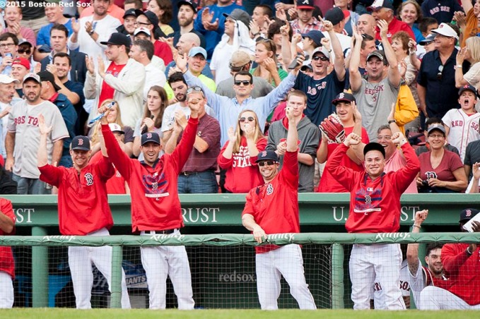 """""""Boston Red Sox players react as Brock Holt hits for the cycle during the eighth inning of a game against the Atlanta Braves at Fenway Park in Boston, Massachusetts Tuesday, June 16, 2015."""""""