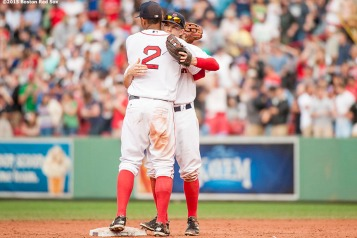 """""""Boston Red Sox shortstop Xander Bogaerts congratulates second baseman Brock Holt following the game after he hits for the cycle during a game against the Atlanta Braves at Fenway Park in Boston, Massachusetts Tuesday, June 16, 2015."""""""