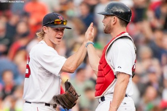 """Boston Red Sox catcher Blake Swihart congratulates second baseman Brock Holt following the game after he hits for the cycle during a game against the Atlanta Braves at Fenway Park in Boston, Massachusetts Tuesday, June 16, 2015."""