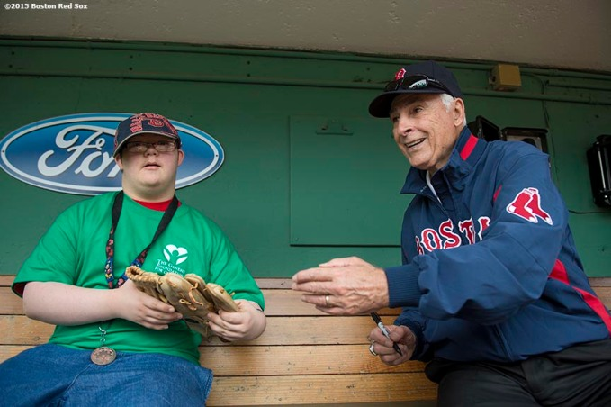 """Former Boston Red Sox outfielder Dick Berardino greets a guest during a Genesis Fund event at Fenway Park in Boston, Massachusetts Thursday, June 18, 2015."""