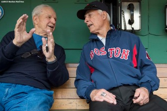 """""""Former Boston Red Sox infielder Ted Lepcio and former outfielder Dick Berardino talk in the dugout during a Genesis Fund event at Fenway Park in Boston, Massachusetts Thursday, June 18, 2015."""""""