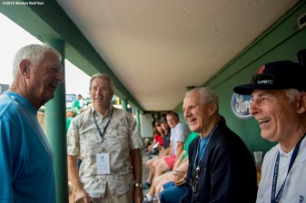 """Former Boston Red Sox left fielder Carl Yastrzemski, pitcher Skip Lockwood, infielder Ted Lepcio and outfielder Dick Berardino talk in the dugout during a Genesis Fund event at Fenway Park in Boston, Massachusetts Thursday, June 18, 2015."""