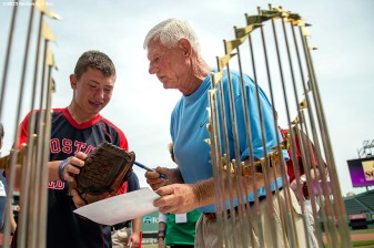 """Former Boston Red Sox left fielder Carl Yastrzemski signs autographs during a Genesis Fund event at Fenway Park in Boston, Massachusetts Thursday, June 18, 2015."""
