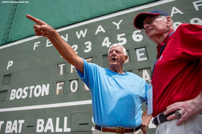 """Former Boston Red Sox left fielder Carl Yastrzemski points as he stands in front of the Green Monster scoreboard during a Genesis Fund event at Fenway Park in Boston, Massachusetts Thursday, June 18, 2015."""